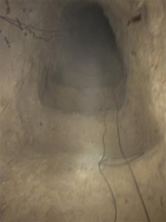 <div class='meta'><div class='origin-logo' data-origin='none'></div><span class='caption-text' data-credit='United States Department of Justice'>The tunnel's passageway is shown. Authorities said it was 3 feet in diameter.</span></div>