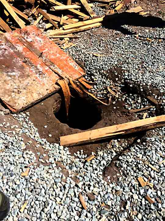 <div class='meta'><div class='origin-logo' data-origin='none'></div><span class='caption-text' data-credit='United States Department of Justice'>A wood plank is removed from a hole in the ground  that served as the opening of the tunnel.</span></div>