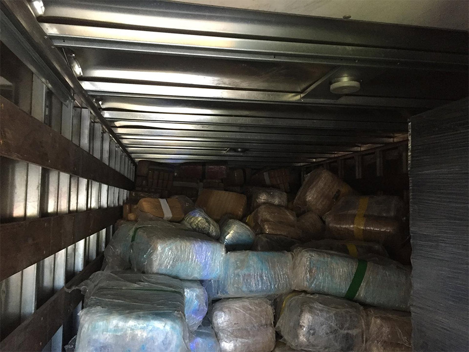 "<div class=""meta image-caption""><div class=""origin-logo origin-image none""><span>none</span></div><span class=""caption-text"">Bundles were found inside a large container near the drug tunnel. (United States Department of Justice)</span></div>"