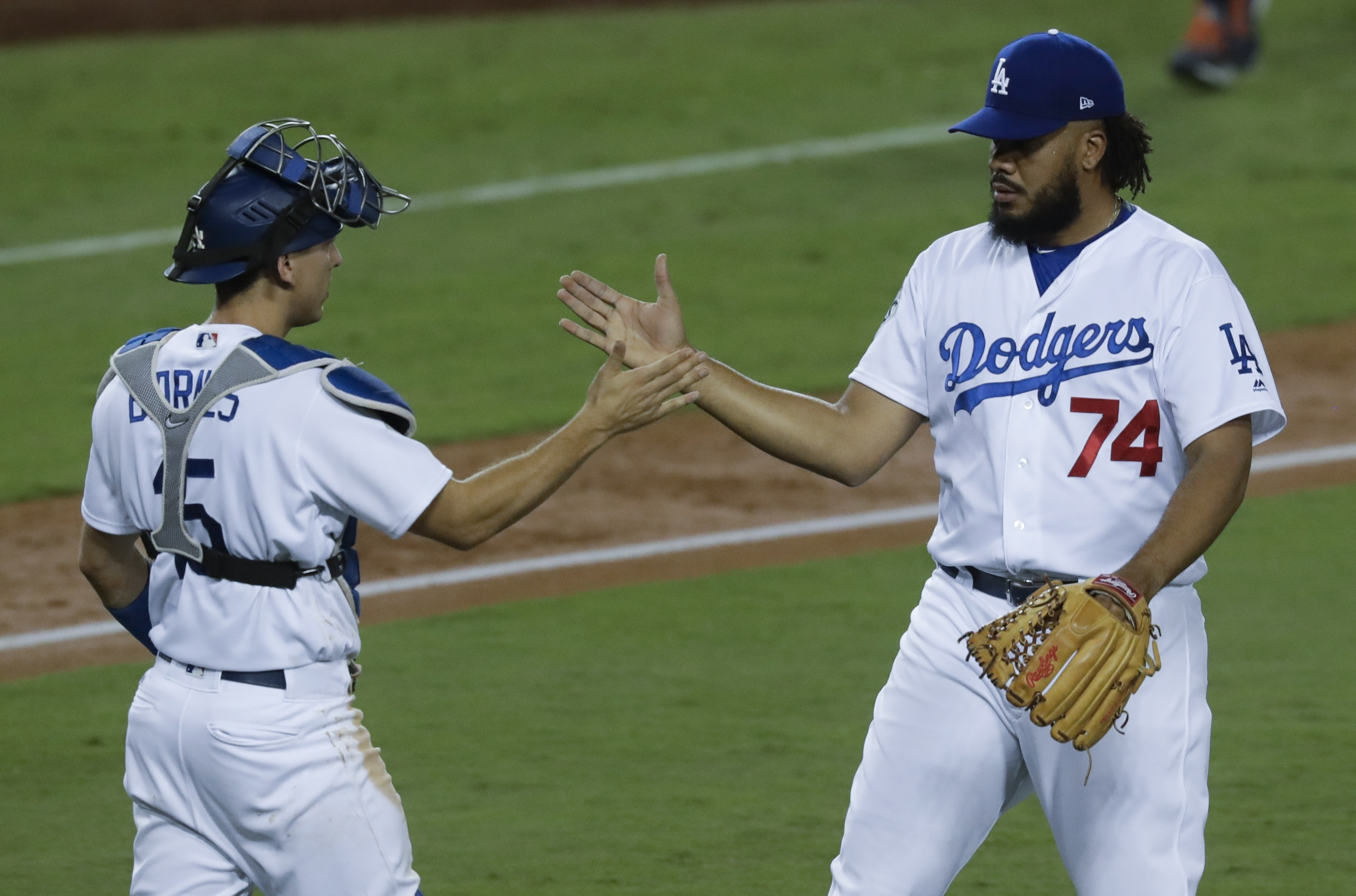 <div class='meta'><div class='origin-logo' data-origin='AP'></div><span class='caption-text' data-credit='(AP Photo/Alex Gallardo)'>Los Angeles Dodgers' Austin Barnes and Kenley Jansen celebrate after a win against the Houston Astros in Los Angeles. The Dodgers won 3-1 to take a 1-0 lead in the series.</span></div>