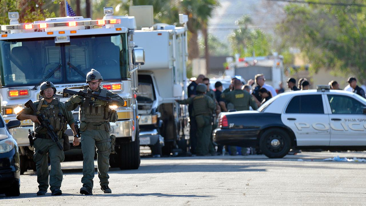 Riverside Country Sheriffs Deputies stand near the scene of a shooting in Palm Springs, Calif., Saturday, Oct. 8, 2016.