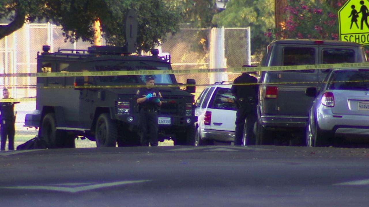 Police block off an area where a man shot three people and injured two others in Pasadena on Saturday, July 12, 2014.
