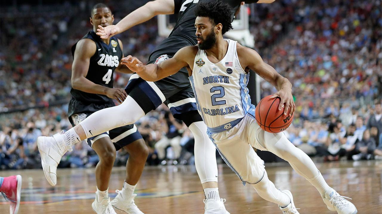 North Carolinas Joel Berry II (2) drives around Gonzagas Przemek Karnowski (24) during the first half in the finals of the Final Four NCAA college basketball tournament, Monday.