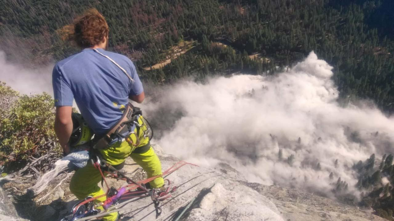 Climber looks at the rockfall from the top of El Capitan