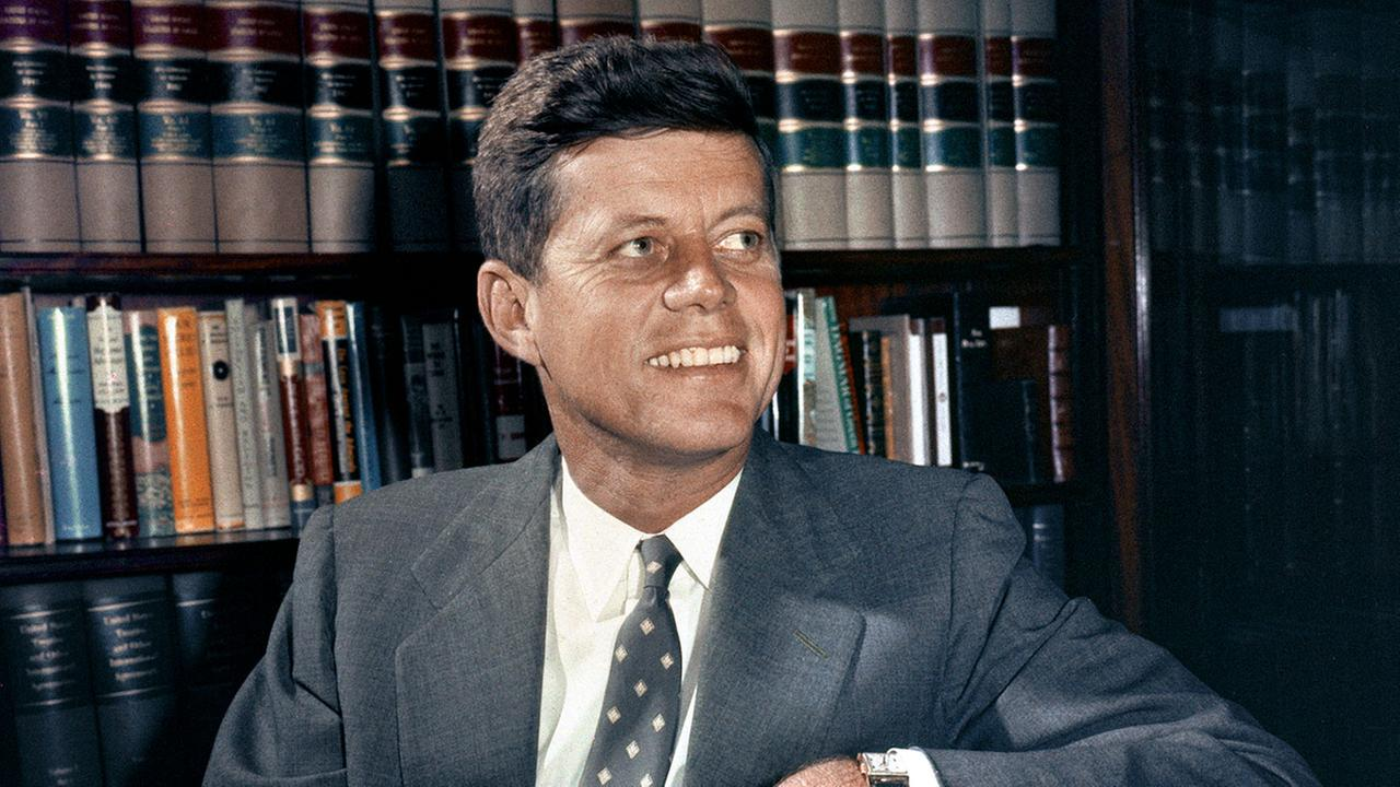 Sen. John F. Kennedy, D-Mass., is shown in his office in Washington.