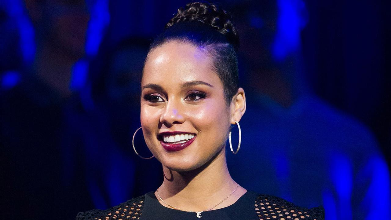 Alicia Keys appears at a concert
