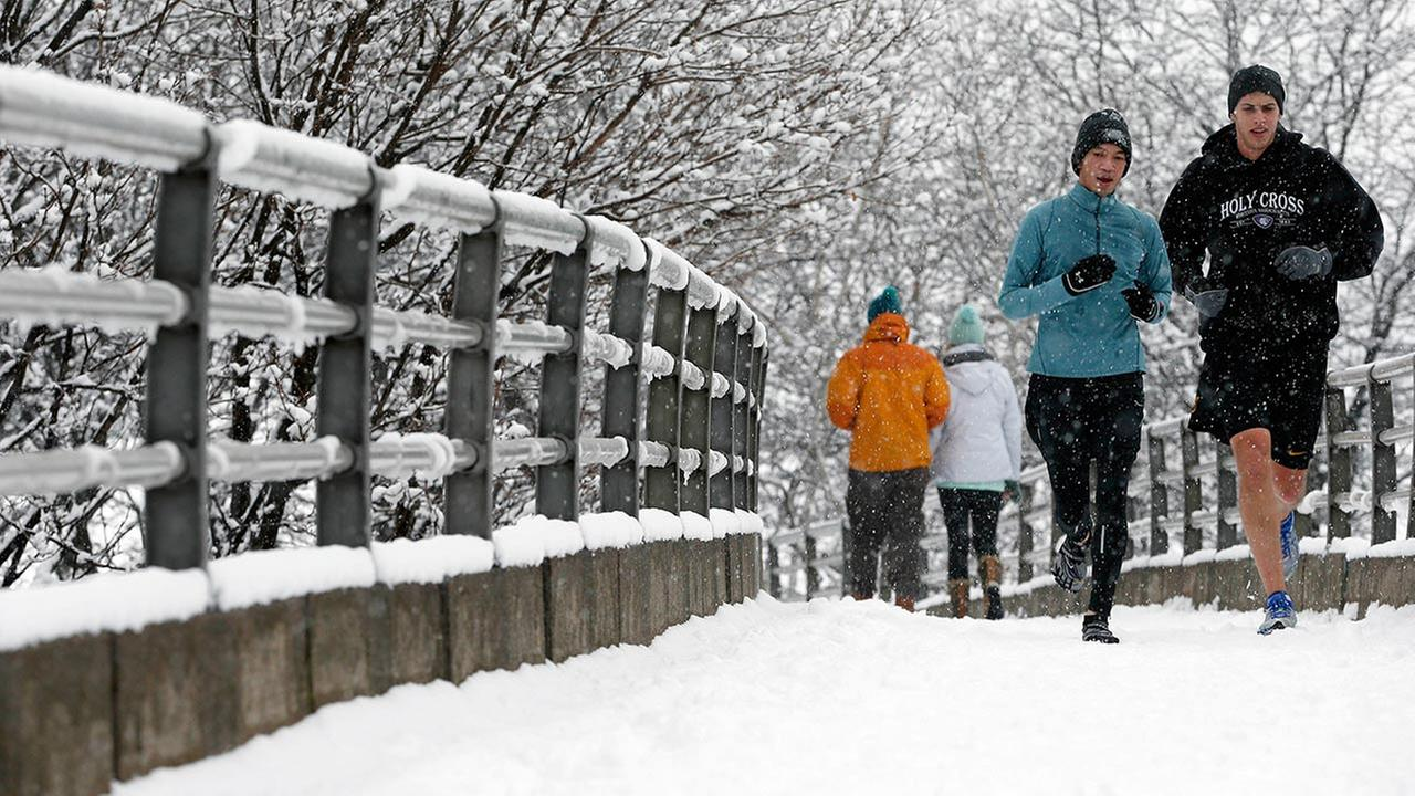 People jog in snow in Boston