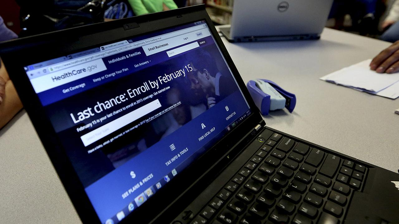 In this Thursday, Feb. 12, 2015 photo, a laptop shows the HealthCare.com web site during an Affordable Care Act enrollment event in Fort Worth, Texas.
