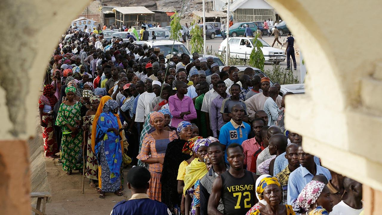 People displaced following attacks by Islamist militants lineup for accreditation before casting their votes, in Yola, Nigeria, Saturday March 28, 2015.