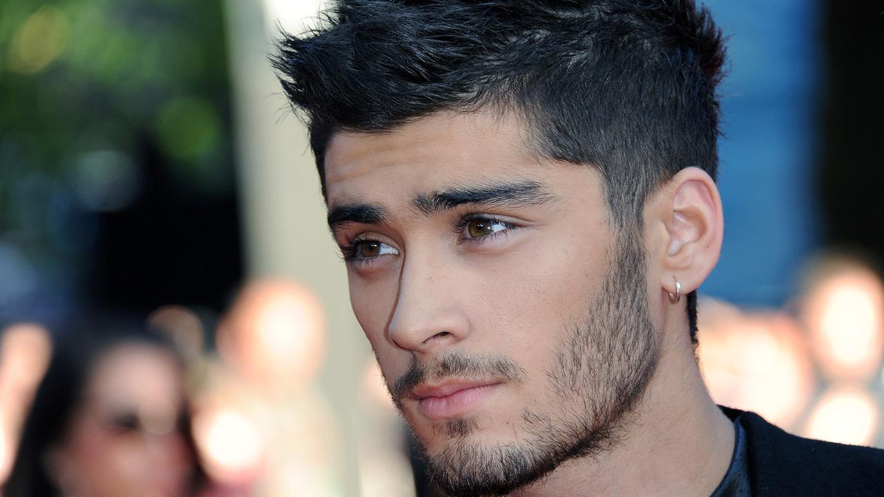 Zayn Malik attends the UK Premiere of One Direction: This Is Us 3D - VIP Arrivals, on Tuesday August 20, 2013, in London.