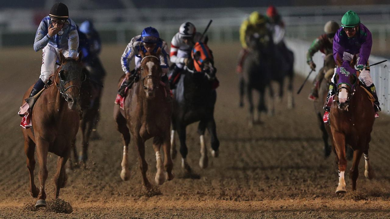 UAE-owned Prince Bishop ridden by William Buick, left, crosses the finish line to win the $ 10,000,000 Dubai World Cup during the Dubai World Cup horse races at Meydan Racecourse in Dubai, United Arab Emirates, Saturday, March 28, 2015.