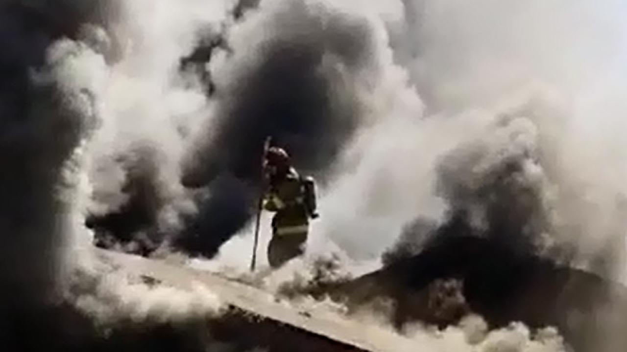 Firefighter falls through roof during Central Fresno house fire