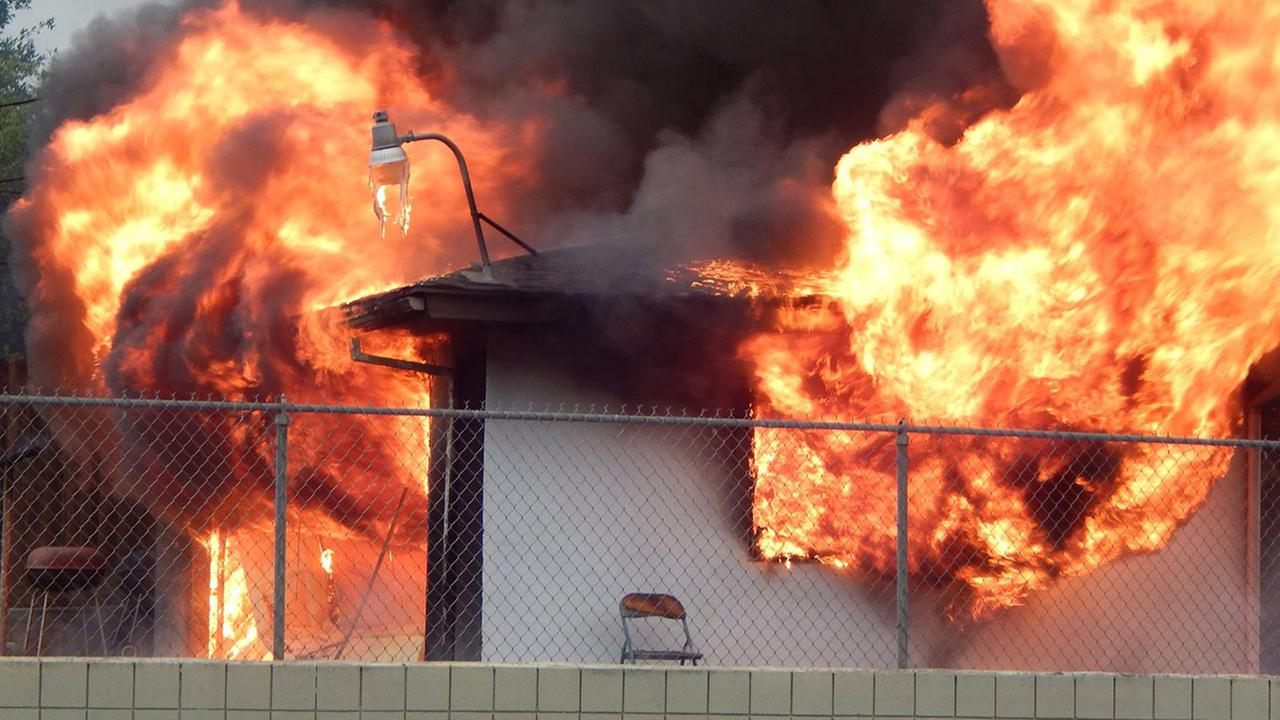 A fire broke out at a home in the area of Tulare Street and Waterman Avenue in Southwest Fresno on Sunday, April 5, 2015.