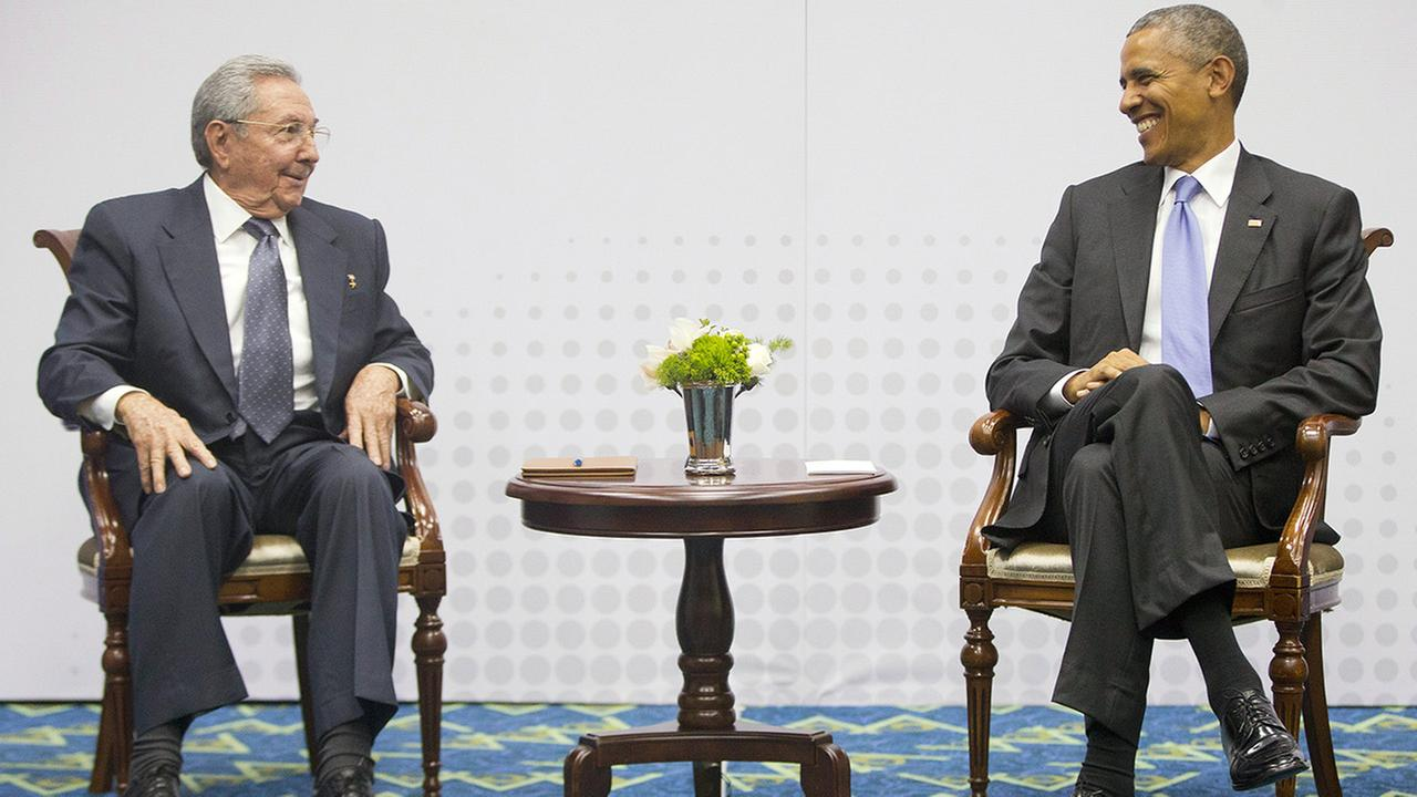 US President Barack Obama, right, smiles as he looks over towards Cuban President Raul Castro, left, during their meeting at the Summit of the Americas in Panama City, Panama, Saturday, April 11, 2015.