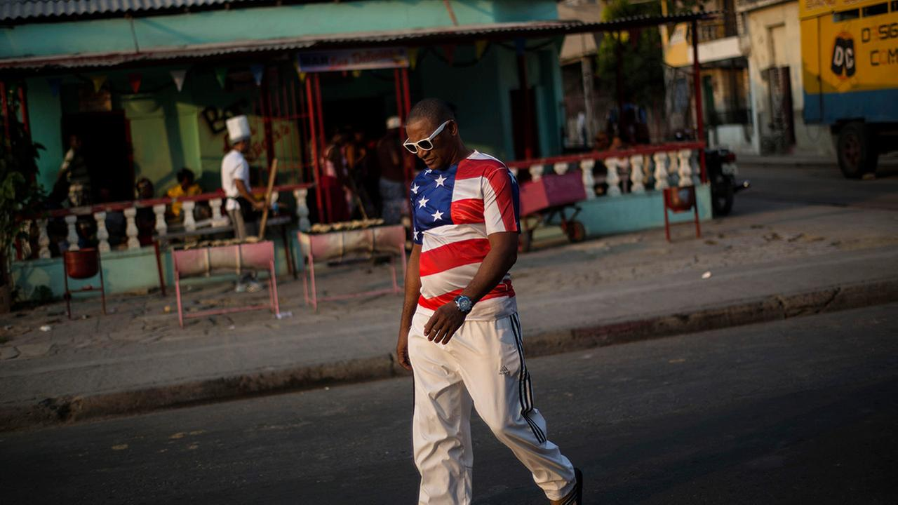 In this March 21, 2015 photo, a man wears a shirt with a U.S. flag design in Santiago, Cuba.