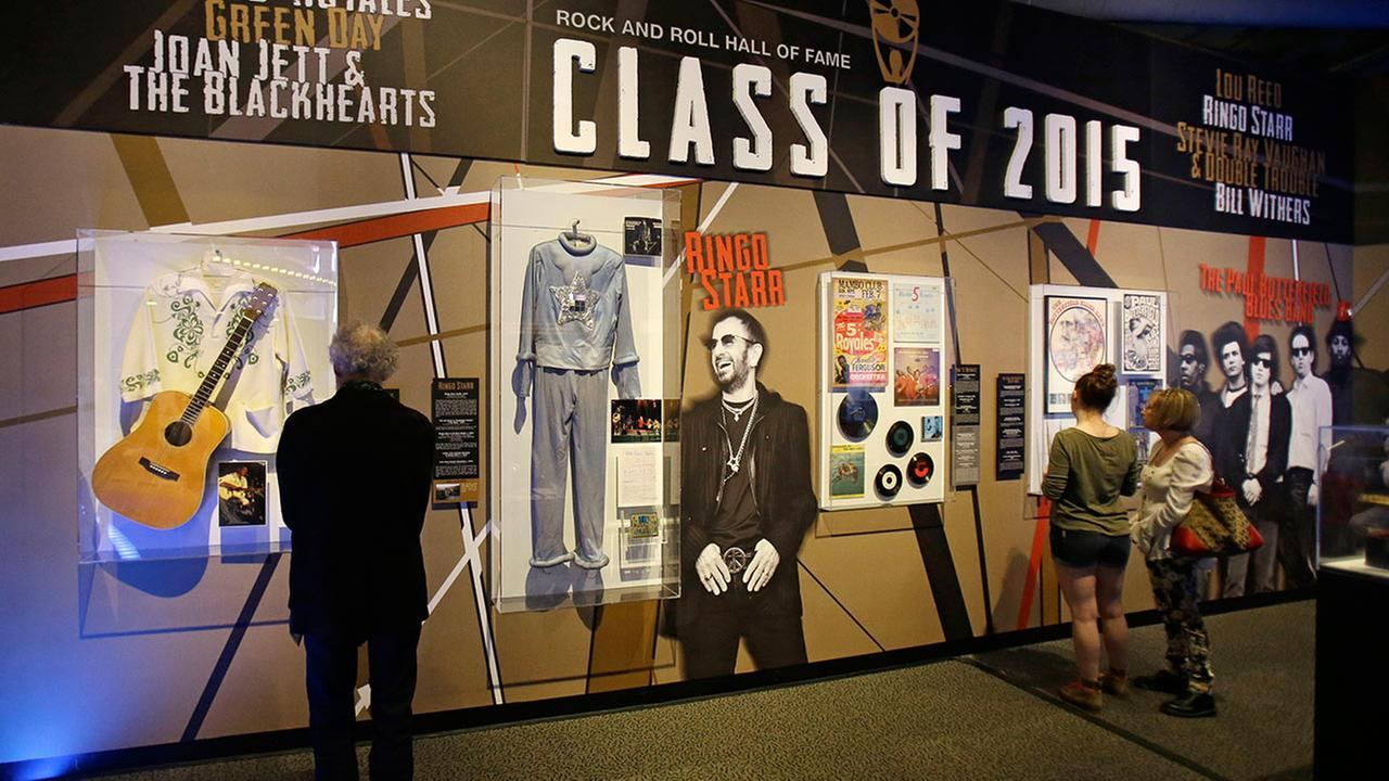 People look at the Class of 2015 exhibit at the The Rock and Roll Hall of Fame and Museum Friday, April 17, 2015, in Cleveland.