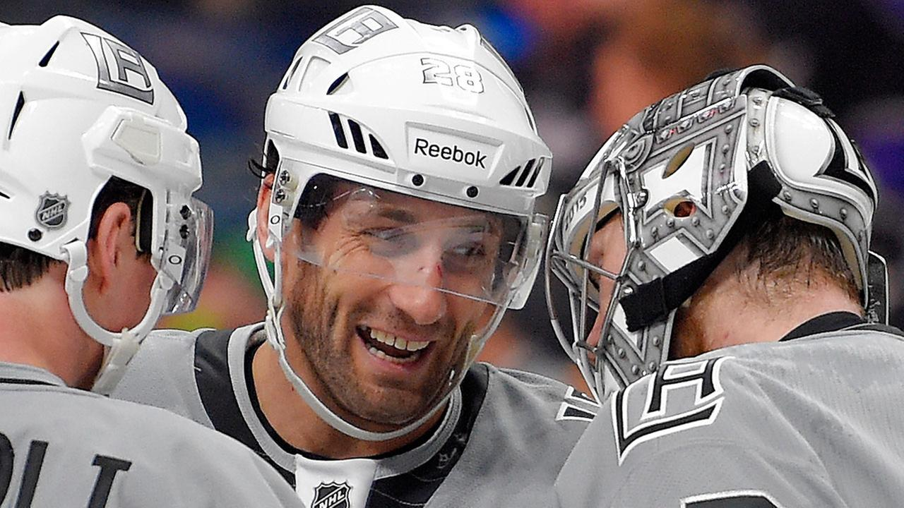 FILE - In this April 11, 2015, file photo, Los Angeles Kings center Jarret Stoll, center, congratulates goalie Jonathan Quick, right, as center Tyler Toffoli watches after an NHL hockey game against the San Jose Sharks in Los Angeles.