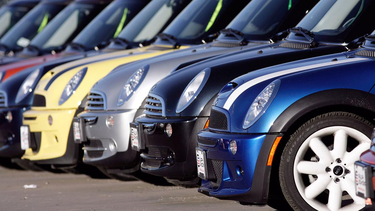 Unsold 2006 Mini Coopers sit in a row on the lot of a Mini dealership in the south Denver suburb of Littleton, Colo., on Sunday, Dec. 10, 2006.