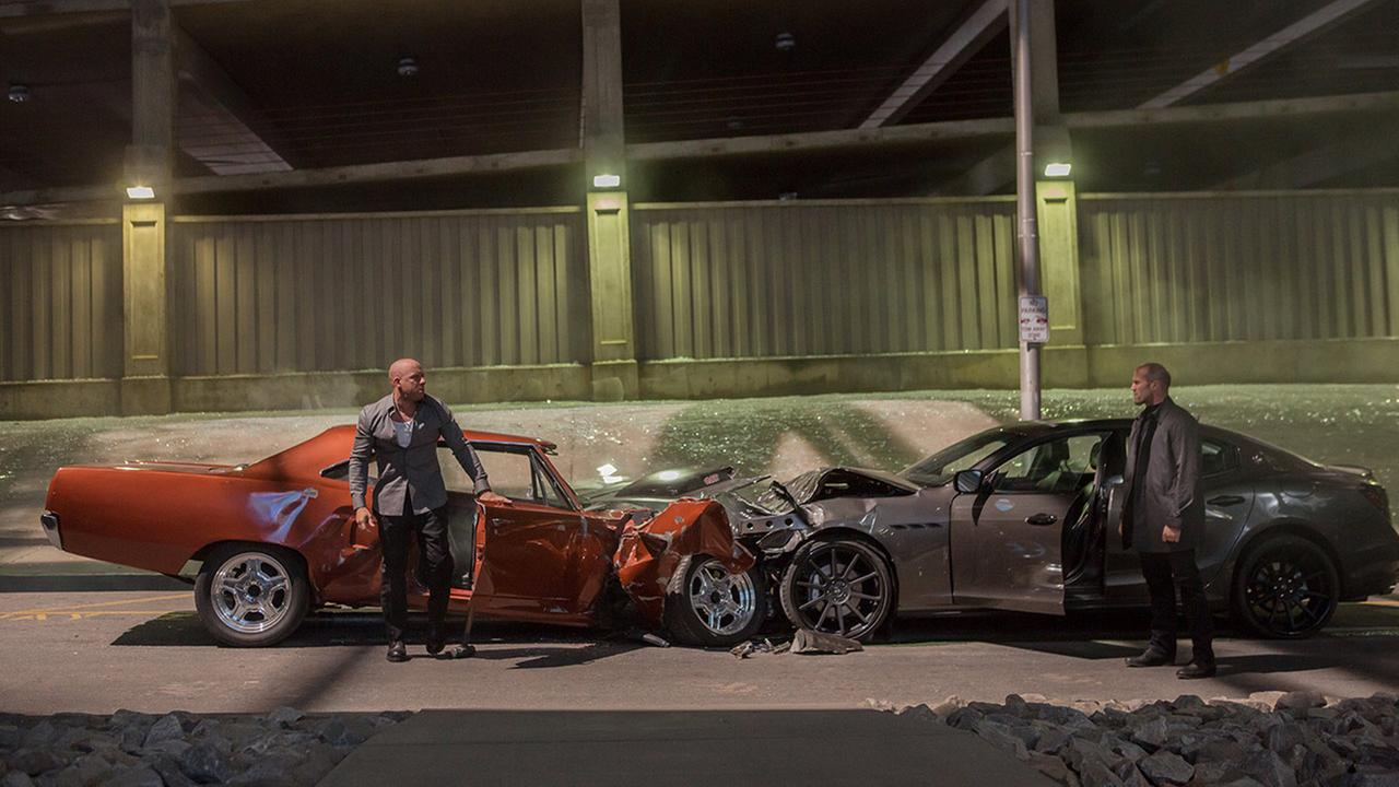 FILE - This file photo provided by Universal Pictures shows, Vin Diesel, left, as Dom Toretto, and Jason Statham, as Deckard Shaw, in a scene from Furious 7.