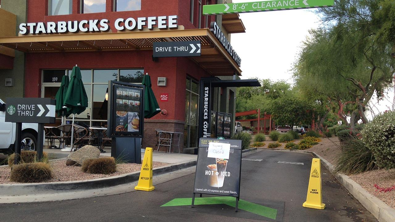 A Starbucks store closes Friday, April 24, 2015, in Phoenix because of computer issues.