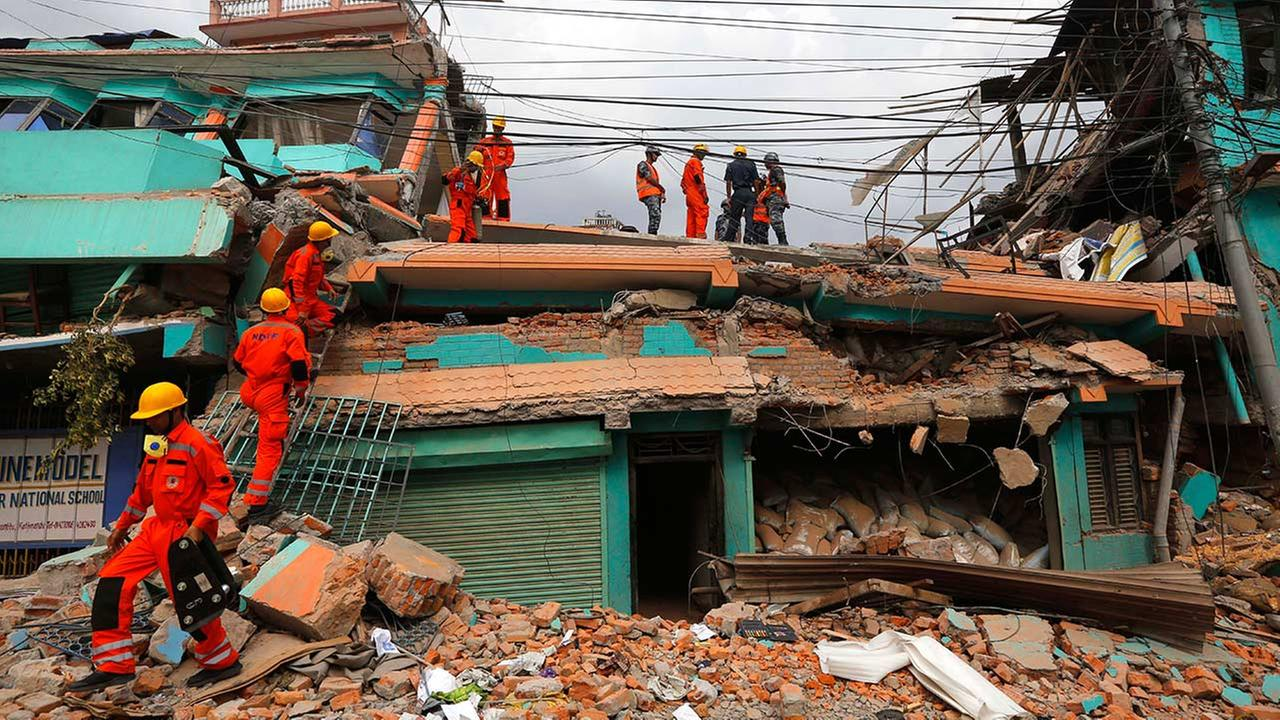 Indias National Disaster Response Force personnel look for survivors in a building, in Kathmandu, Nepal, Sunday, April 26, 2015.