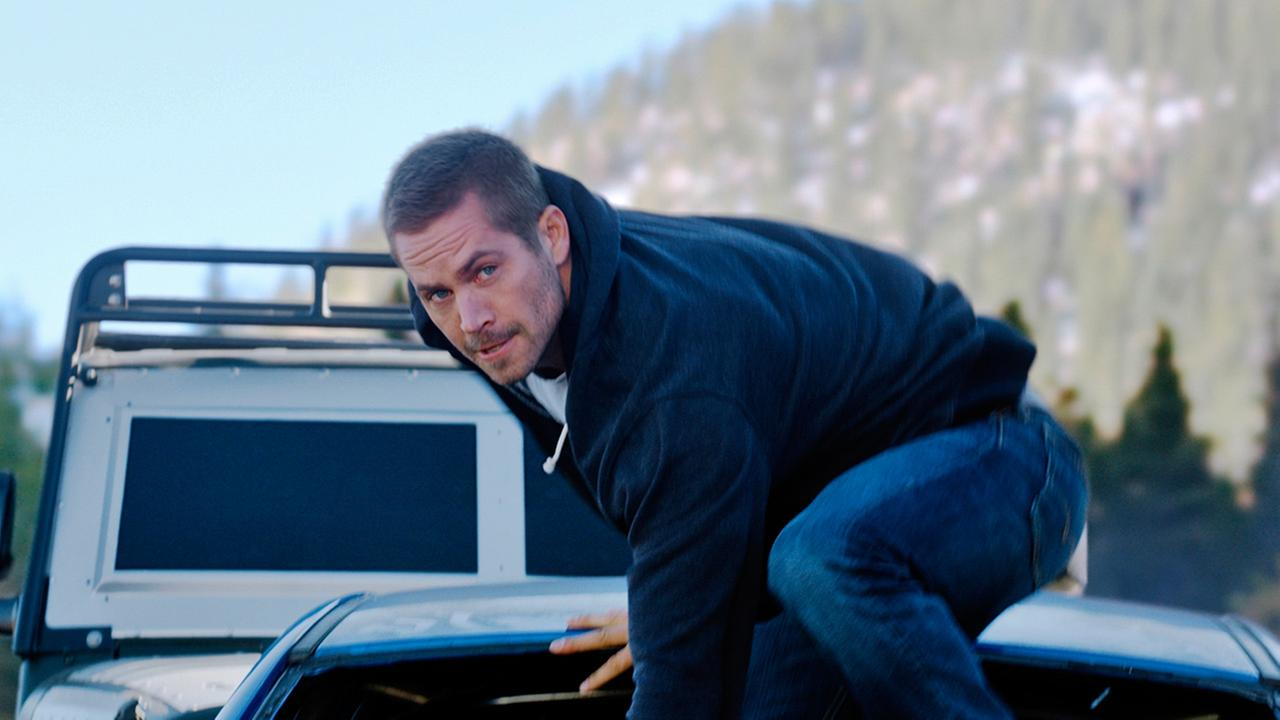 FILE - This undated file photo provided by Universal Pictures shows, Paul Walker as Brian, in a scene from Furious 7.