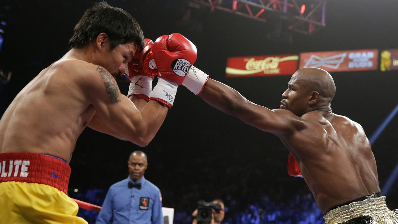 Floyd Mayweather Jr., right, trades blows with Manny Pacquiao, from the Philippines, during their welterweight title fight on Saturday, May 2, 2015 in Las Vegas.