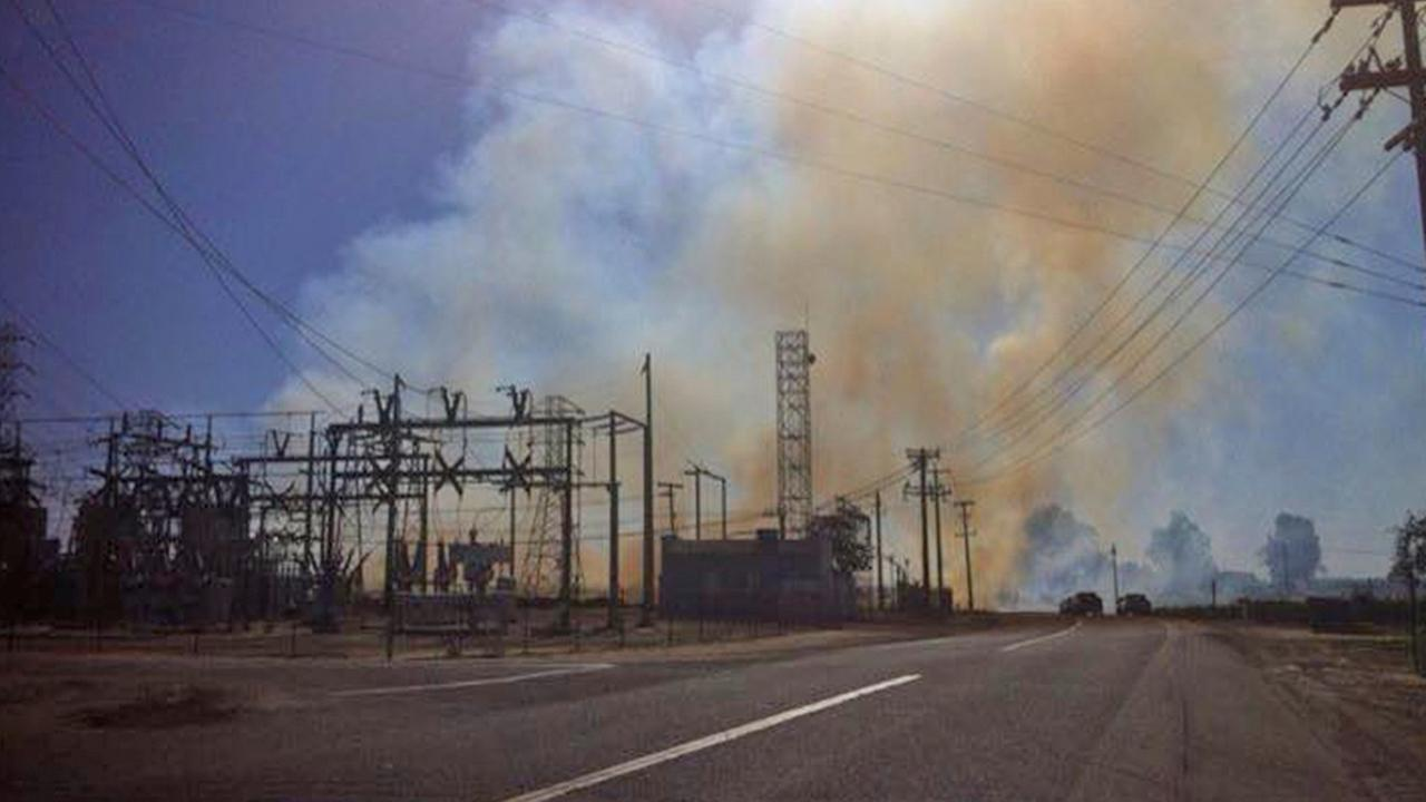 A vegetation fire threatened structures near Kingsburg on Sunday, May 3, 2015.