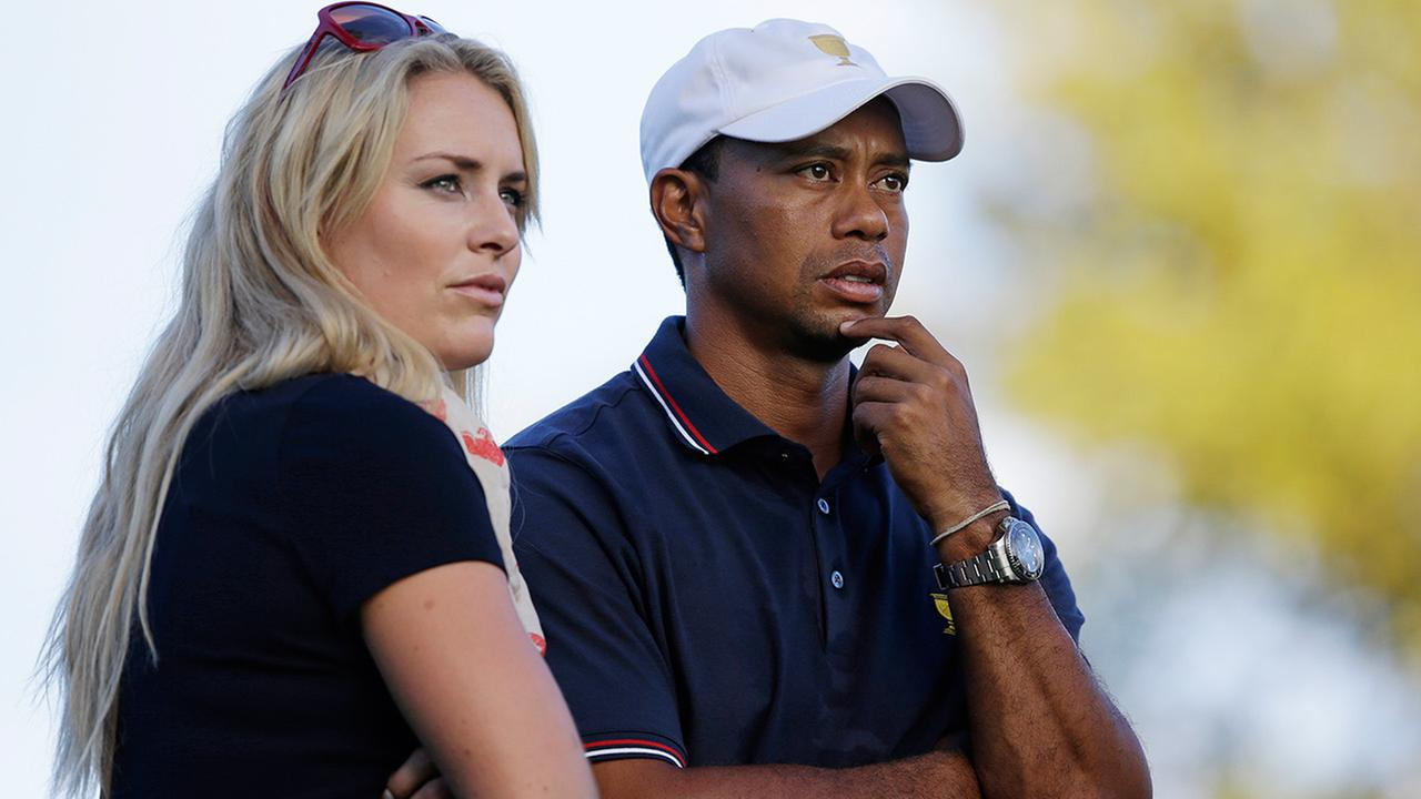 FILE - This Oct. 3, 2013 file photo shows Tiger Woods watching with his girlfriend Lindsey Vonn at the Presidents Cup golf tournament at Muirfield Village Golf Club in Dublin, Ohio.
