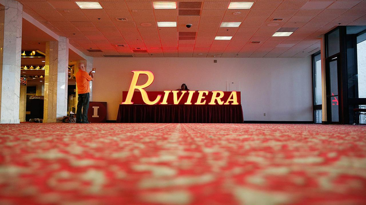 People take pictures around a sign at the Riviera hotel and casino Monday, May 4, 2015, in Las Vegas.