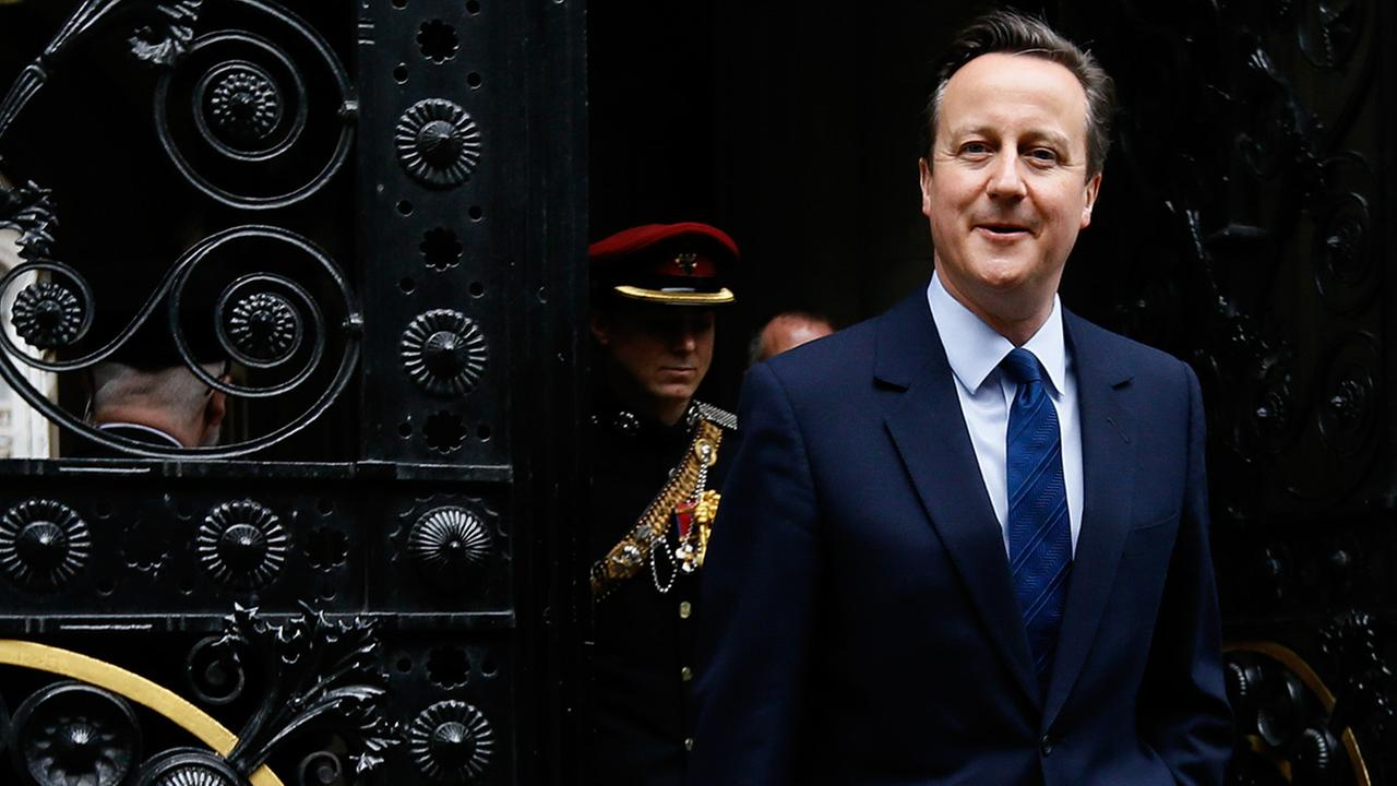 Britains Prime Minister David Cameron returns to 10 Downing Street in London after attending a VE Day service at the Cenotaph, Friday, May 8, 2015.