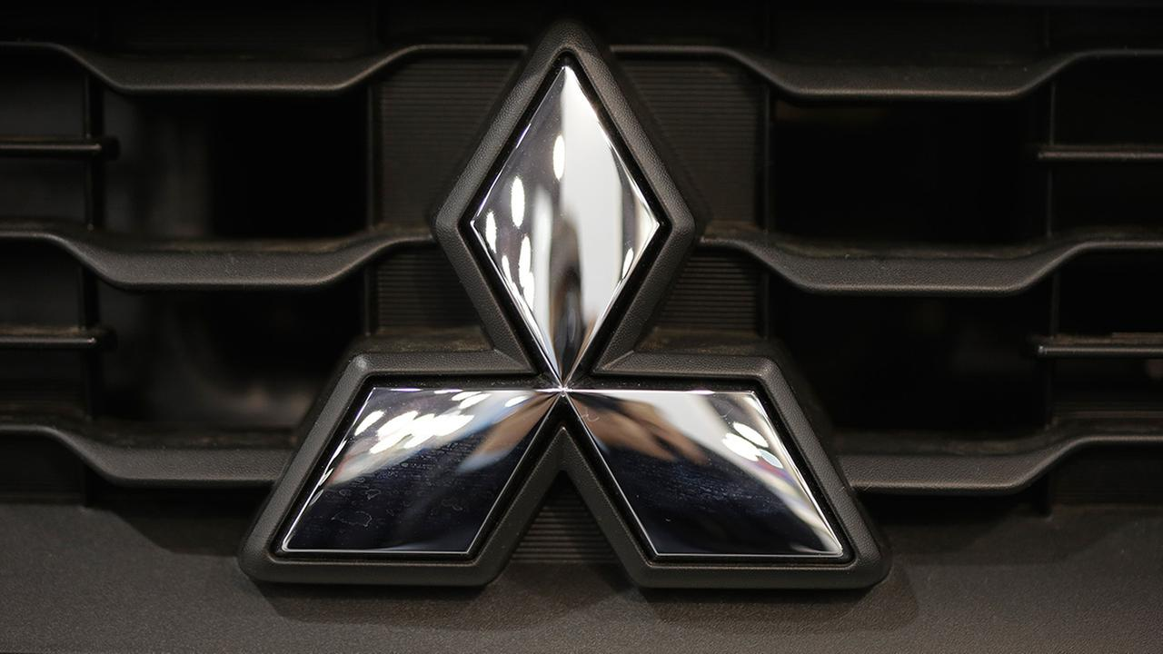 In this Friday, Jan. 18, 2013 photo, shown is a Mitsubishi emblem at the Philadelphia Auto Show in Philadelphia.
