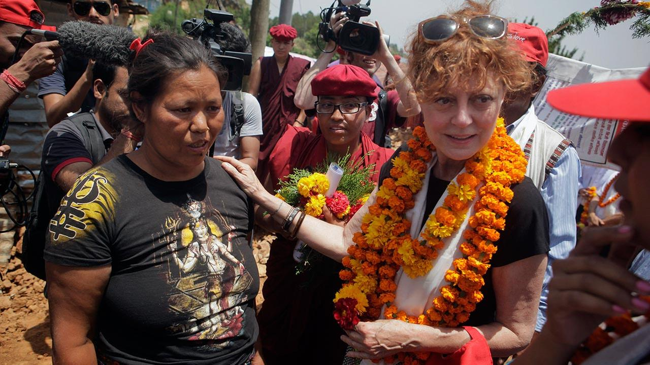 Oscar-winning Hollywood actress Susan Sarandon, right, comforts Kanti Maya Tamang, who lost her husband and daughter in the April 25 earthquake.