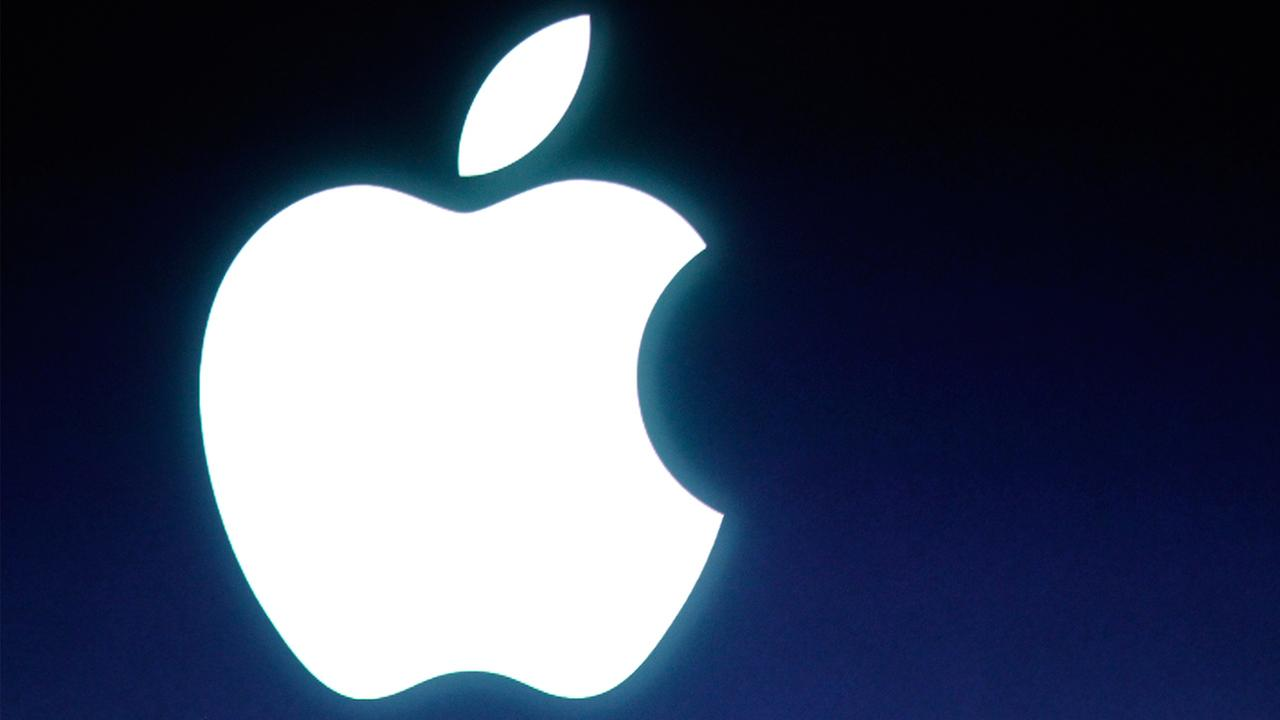 Apple logo during announcement at Apple headquarters in Cupertino, Calif., Tuesday, Oct. 4, 2011.