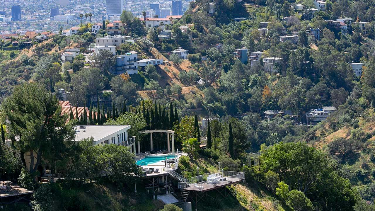 FILE - In this April 8, 2015 file photo, a home with a large pool is visible in the Hollywood Hills area of Los Angeles.