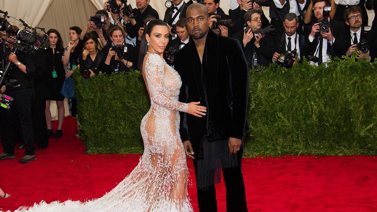 Kim Kardashian and Kanye West arrive at The Metropolitan Museum of Arts Costume Institute benefit gala celebrating China: Through the Looking Glass on Monday, May 4, 2015, in New York.