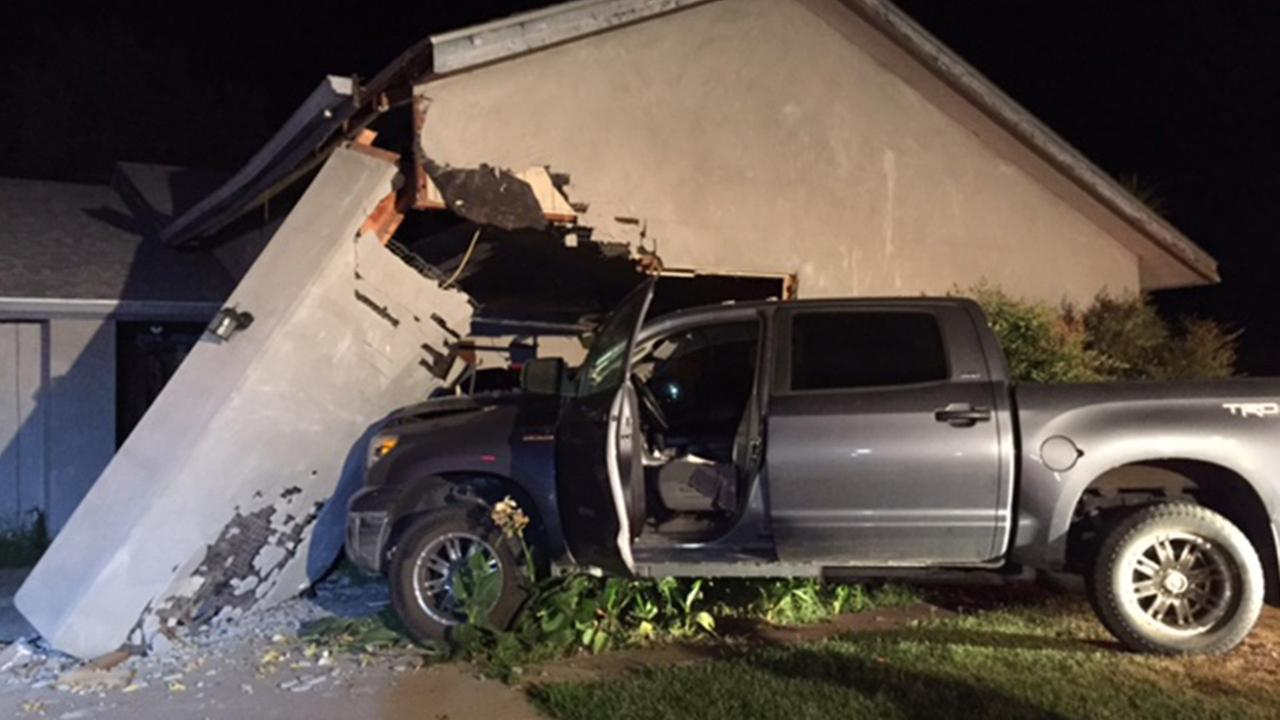A truck crashed into a house in Visalia on Sunday, June 7, 2015.