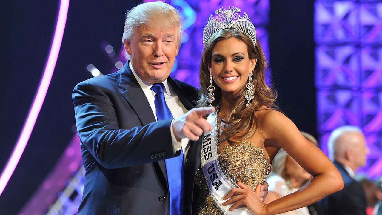 FILE - In this June 16, 2013 file photo, Donald Trump, left, and Miss Connecticut USA Erin Brady pose onstage after Brady won the 2013 Miss USA pageant in Las Vegas, Nev.