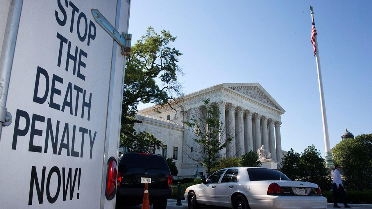 A vehicle parked near the Supreme Court in Washington, has signage that says Stop The Death Penalty Now, Monday June 29, 2015.