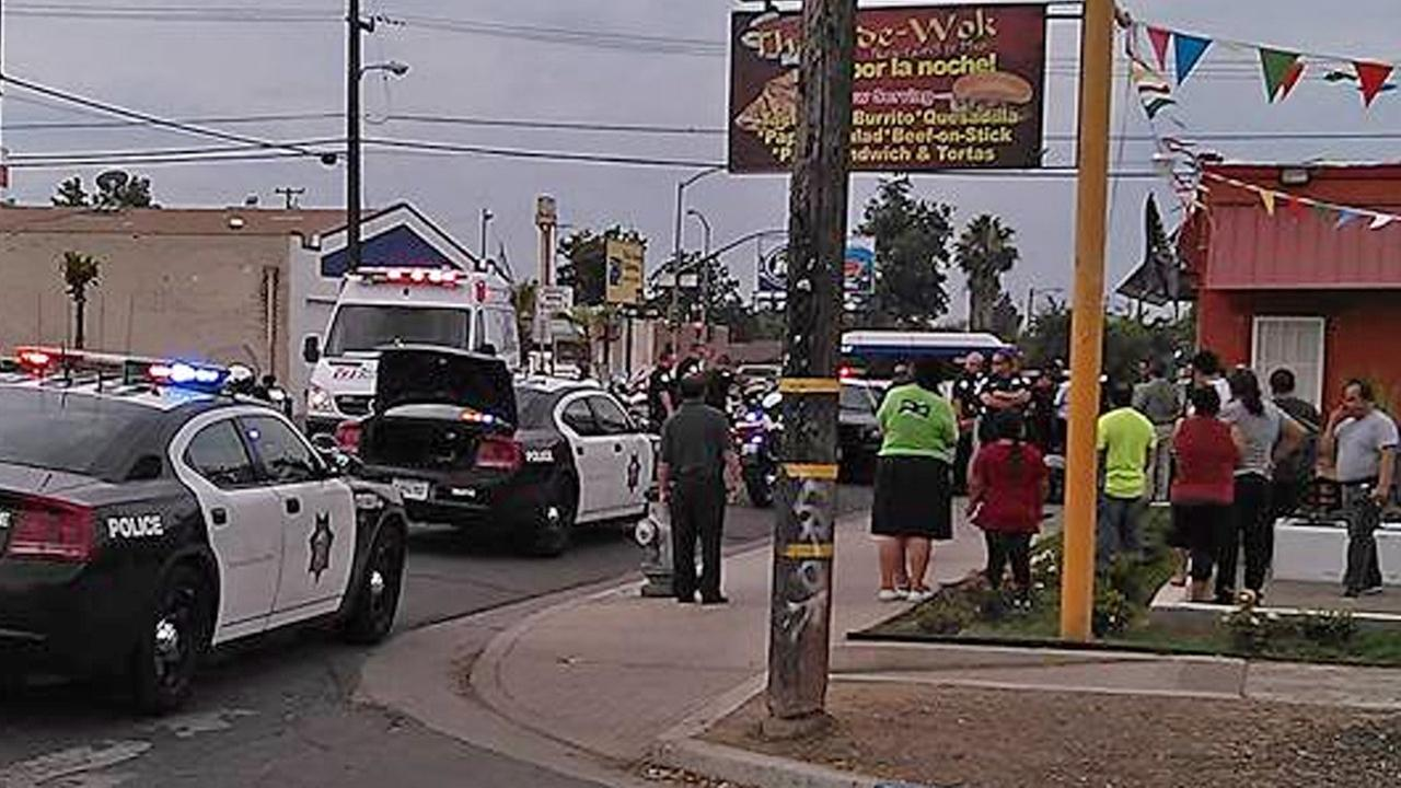 Fresno police respond to the area of Maple and Iowa avenues after an officer fell off his motorcycle on Wednesday, July 1, 2015.