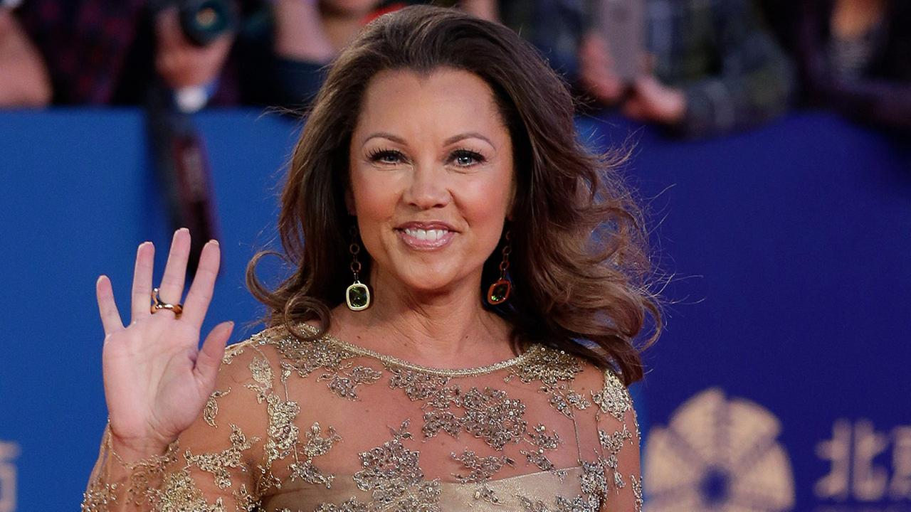 FILE - In a Thursday, April 23, 2015 file photo, Vanessa Williams waves as she arrives on the red carpet for the closing ceremony of the 5th Beijing International Film Festival in the Huairou district of Beijing.