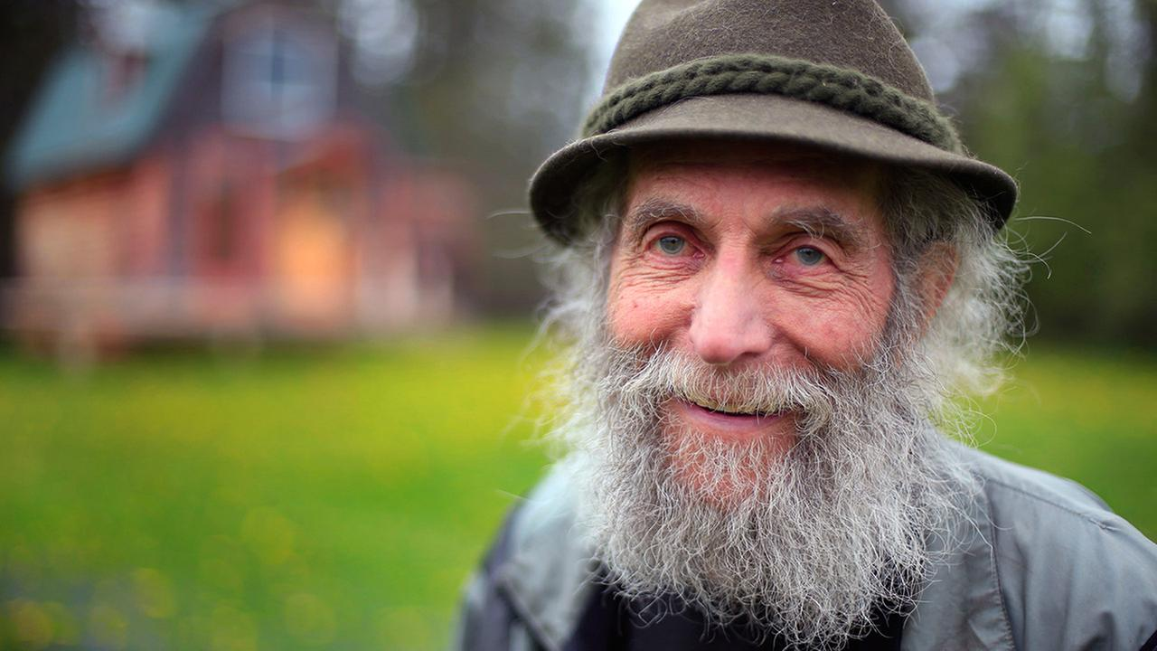 FILE- In May 23, 2014, file photo, Burt Shavitz poses for a photo on his property in Parkman, Maine.
