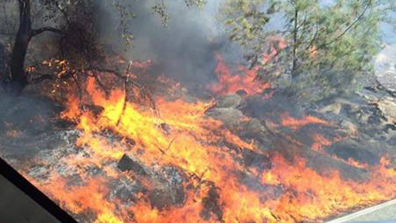 A fire burns north of the Fresno County community of Auberry on Saturday, July 18, 2015.