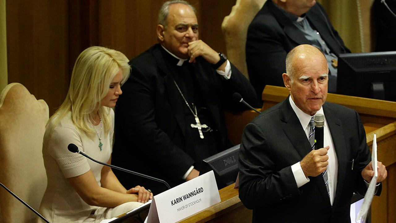 California Gov. Jerry Brown, right, delivers his speech in the Synod Hall as he attends a conference on Modern Slavery and Climate Change at the Vatican, Tuesday, July 21, 2015.
