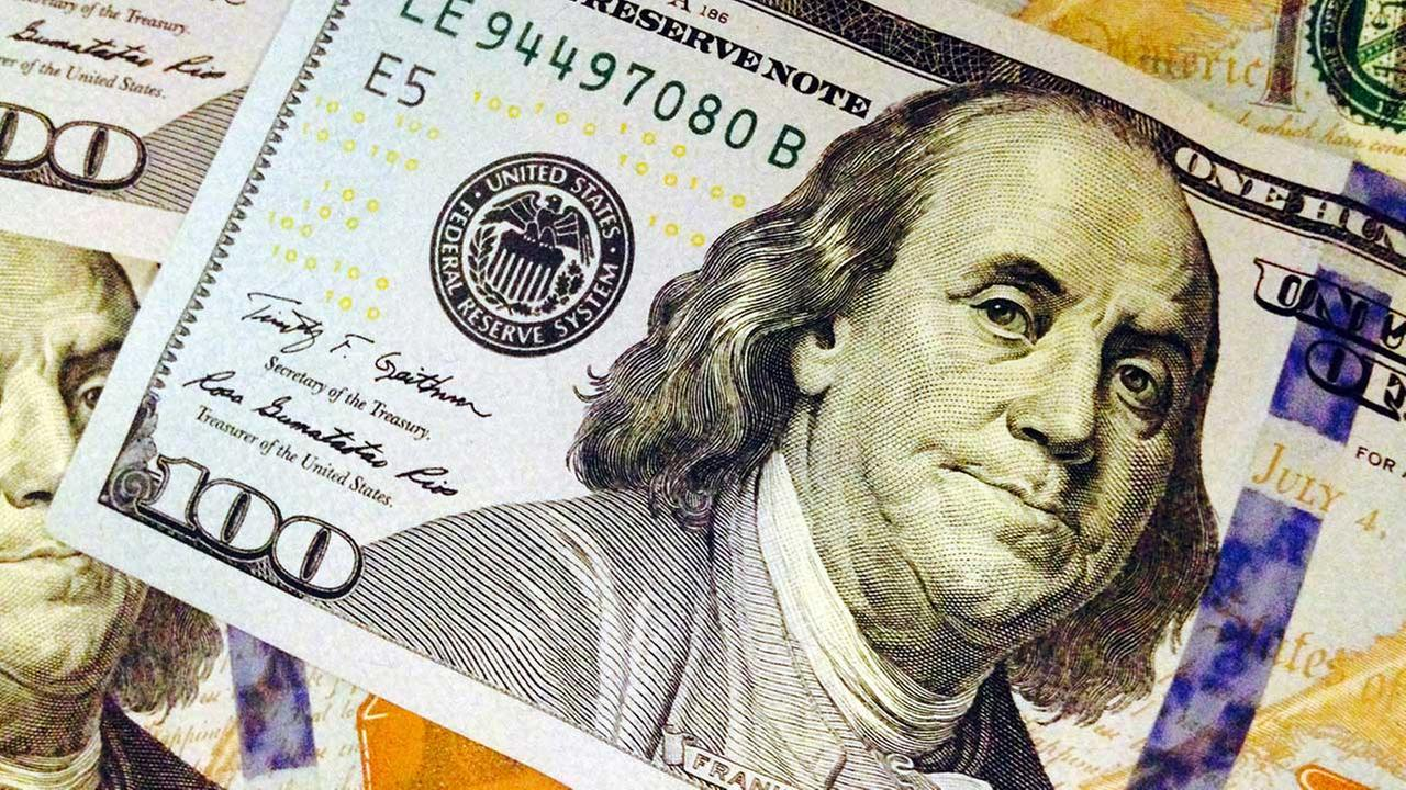 FILE - This Feb. 2, 2015, file photo, depicts a part of a U.S. $100 bill.