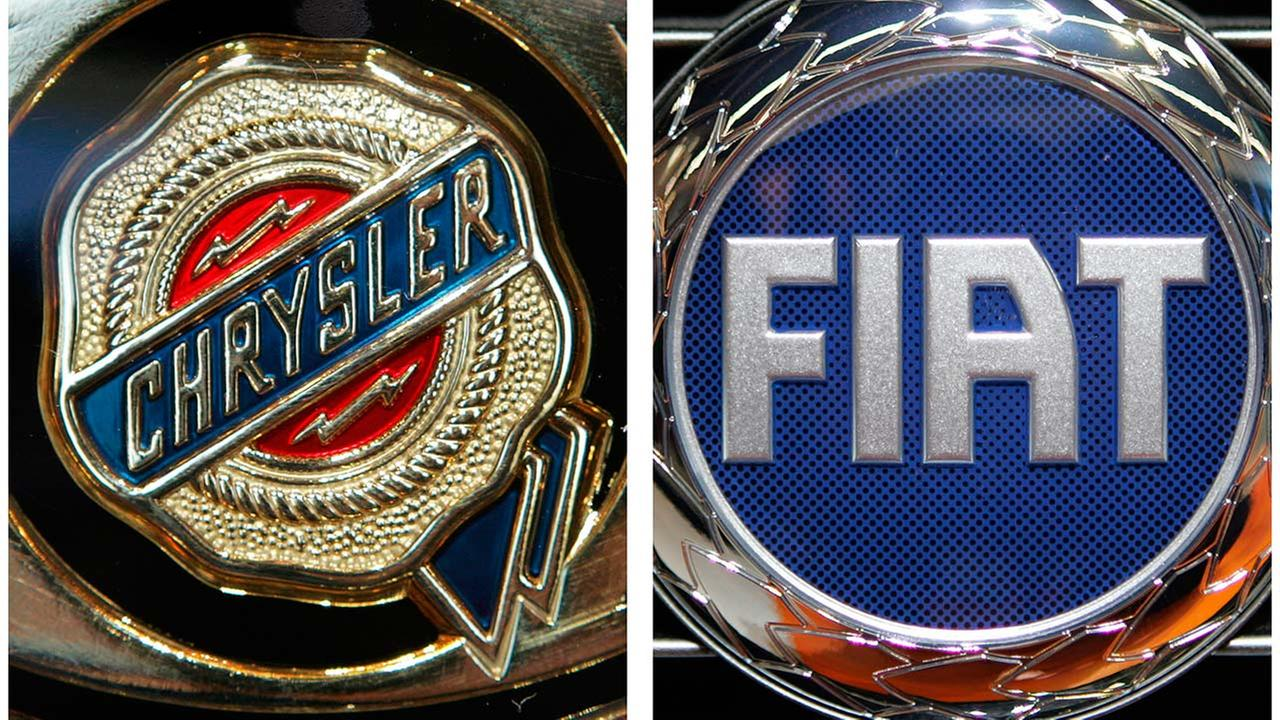 In this combo made from Sept. 22, 2005 file photos, the Chrysler, left, and Fiat logos are shown at the International Auto Show in Frankfurt, central Germany.