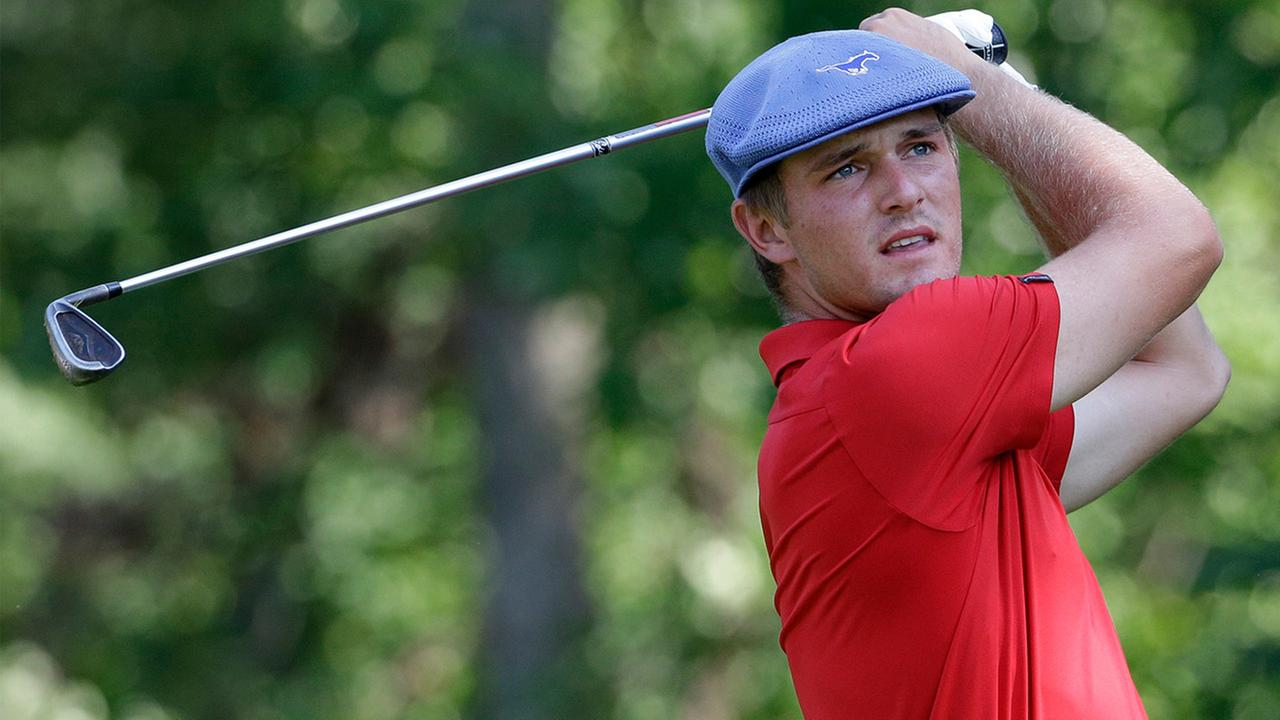 Bryson DeChambeau watches his tee shot on the 25th hole during the championship match of the U.S. Amateur golf tournament at Olympia Fields Country Club on Sunday, Aug. 23, 2015, in Olympia Fields, Ill.
