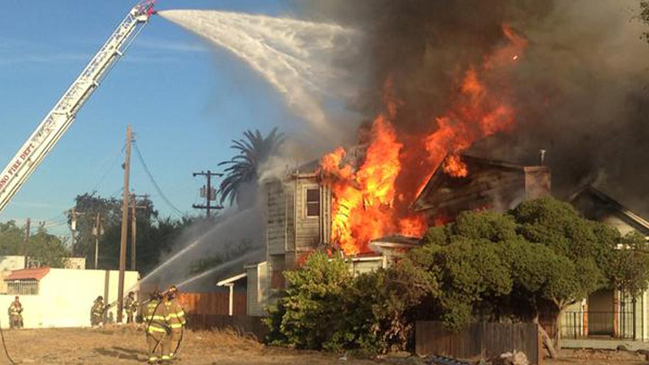 A fire broke out at a home in Downtown Fresno on Saturday, Aug. 29, 2015.