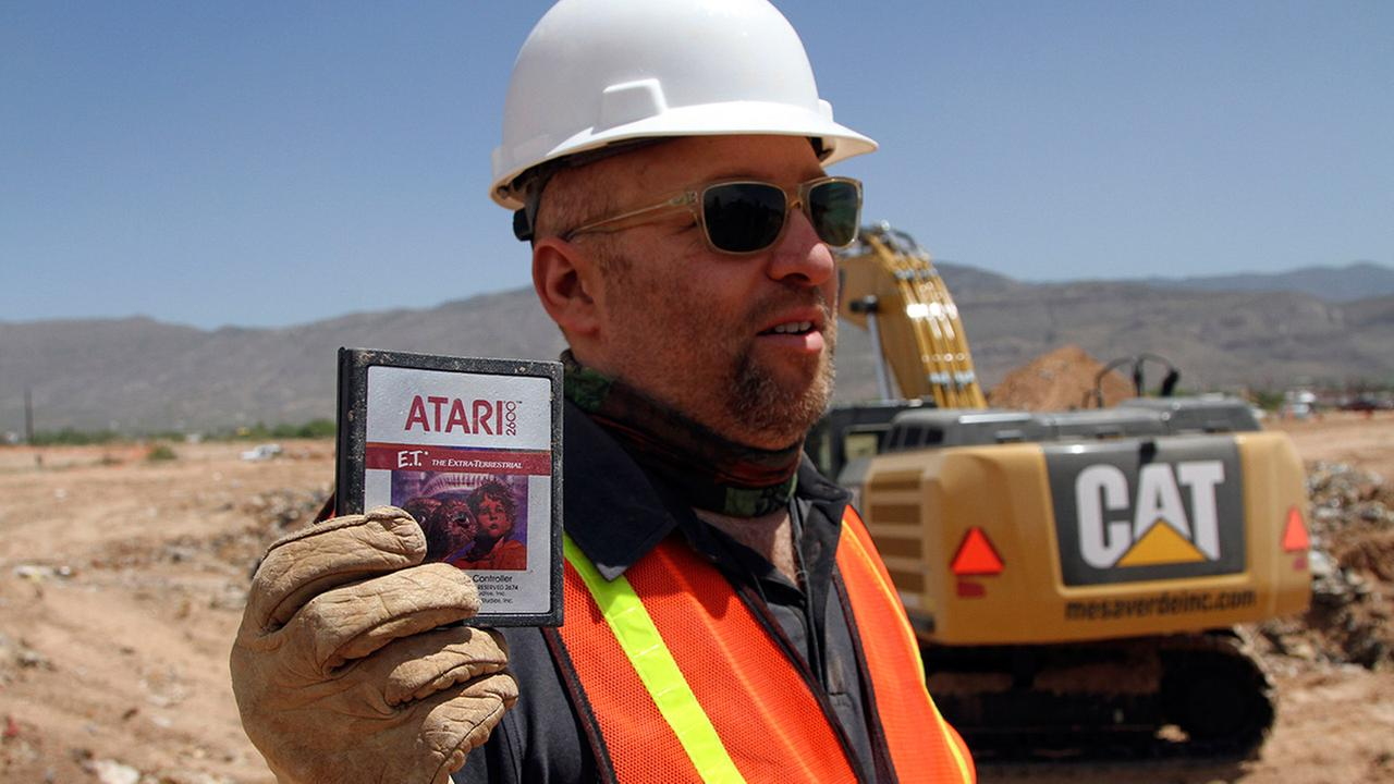 FILE - In this April 26, 2014 file photo, film director Zak Penn shows a box of a decades-old Atari E.T. the Extra-Terrestrial game found in a dumpsite in Alamogordo, N.M.