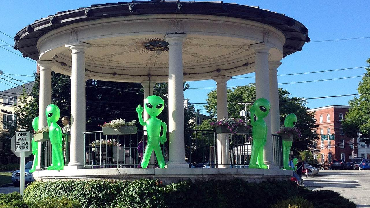 In this photo taken Aug. 30, 2014, and provided by Bill Smith, inflatable toy aliens adorn a gazebo in Exeter, N.H., during the annual UFO Festival.